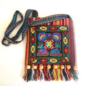 Traditionally embroidered beaded bag with Fringe